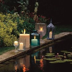 Love the use of different containers for candles...even a wine glass~