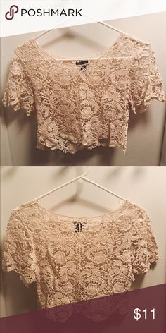 Cream colored lace crop top This sweet lace crop top made out of 100% cotton looks SO sweet with high waisted jeans or a cute flouncy skirt. Pair it with a cute bralette underneath and you're set! Poetry Tops Crop Tops