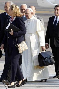 Pope Francis Carries His Own Bag Onto His Flight To Brazil (PHOTOS)
