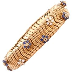 Retro Sapphire Diamond Yellow Gold Floral Decor Snake Bracelet | From a unique collection of vintage retro bracelets at https://www.1stdibs.com/jewelry/bracelets/retro-bracelets/
