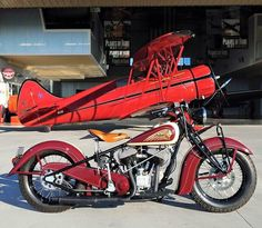 World War II Fighter Trainer Authentic 1942 WACO UPF-7 Biplane (220 hp Continental)  and 1939 Indian motorcycle.
