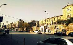 حلب -كنيسة في اليمين ومسجد في اليسار في نفس الشارع بمدينة حلب