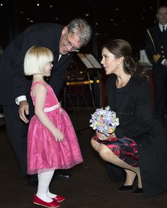 (C) Frede Olesen, Chairman of the Danish Cancer Society, introduces little Anna to Crown Princess Mary of Denmark (R).  Children's House has been nominated for the prize by Julie Summer, who is the mother of 5-year-old Anna, who got cancer as 2-year-old.  Anna is now quickly reported, but in a year and a half was børnehuset family's lifeline.