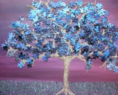 Buy a cheap jigsaw.  Buy a cheap(ish) canvas.  Paint a skyscape.  Paint the ground.  Paint a skeleton tree.  Stick the jigsaw on.