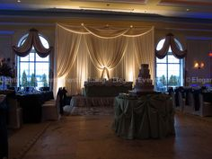 This Ivory Sweet Heart Table Backdrop accented with soft white uplighting gives the room an elegant, romantic ambiance.