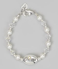 Shimmery and delicate, this oh-so-elegant bracelet will give any little princess' wrist an adorable glow. Boasting some precious pearls and glimmering crystals, it will become a cherished keepsake that's sure to be worn with pride for years.1'' extender