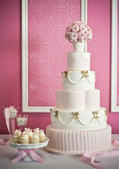 This stunning pink and gold masterpiece, designed by Luisa Galuppo Cakes is glamourously adorned with fondant pearls, flowers and accessories.