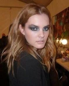"Backstage at Diane von Furstenberg, lead makeup artist James Kaliardos created ""iridescent smoky eyes inspired by butterfly metamorphosis and peacock colors."" 