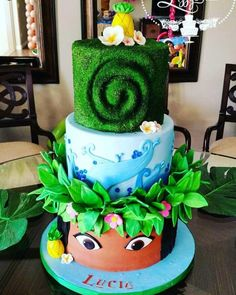 3 tier Moana cake Top tier Represents Te Fiti Middle tier represent the ocean And the bottom tier Represents Moana This cake may be one of my favorties. Cynthia from Cakes By Cynthia White was a big help with achieving the moss look on my top tier Moana Party, Moana Birthday Party, Luau Birthday, 6th Birthday Parties, Luau Party, Birthday Ideas, Bolo Moana, Bolo Cake, Disney Cakes