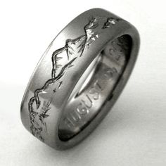 Wedding band for men engraved with mountains - perfect for a geologist like myself.