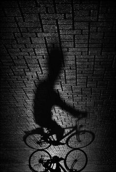 I think this photo is really interesting, I love how the shadow distorts the bike and person, making them look larger than thy really are.