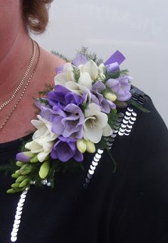Freesia Shoulder Corsage something like this would be perfect for my momma but in pinks