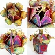 This is a handmade machine stitched textile flower pod, it has a restricted secret opening at the top to hide away treasures within, it is made to look like a flower and has leaves hanging from gold threads. It uses hand dyed cottons and hand dyed silk...