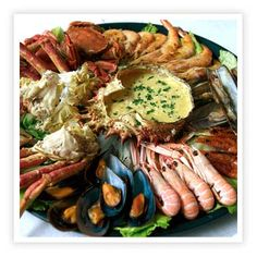 A platter of assorted seafood, bread and wine, eaten in the shade, with a view..... Can you give me one good reason to live in England? No, thought not. Mariscada de Sesimbra, Portugal