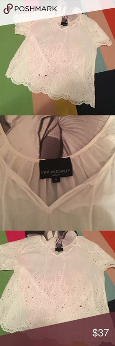 Cynthia Rowley sheer top NWOT size 1X Cynthia Rowley 100% cotton semi sheer top with cute eyelets throughout and the cut of the sleeve in picture 4 is to die for. NWOT ties with silver accents at bottom by neckline perfect for under a Levi cropped jacket and colored jeans and cute flats. Retail $79 price is firm unless bundled because I'm practically giving them away. Enjoy!! Cynthia Rowley Tops Blouses