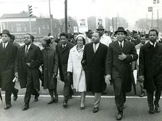 Martin Luther King Jr. and his wife, Coretta Scott King, marching in 1966 on the Georgia state capitol.