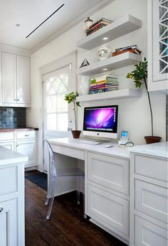 Amazing kitchen with chunky floating shelves over built-in desk paired with Victoria Ghost Chair over oak hardwood floors.