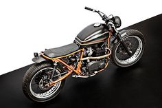 """ONLINE EXCLUSIVE Ever heard of a Kawasaki Z970? Neither had we. But that's the moniker the Wrenchmonkees have given their latest custom, a stunning Z750B that's been bored out to almost a liter. It's the pet project of company founder Per Nielsen, who wanted to build """"the perfect City-Dirt tracker"""" with a beefed-up motor and…"""