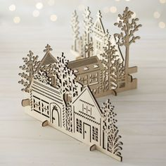 Our charming village is laser-cut in realistic detail, easily assembled into a dimensional, freestanding conversation piece.  This cluster of homes, churches and trees can be paired with our laser-cut animals and trees for a full decorative statement. Laser-cut plywoodNatural finishMade in China.