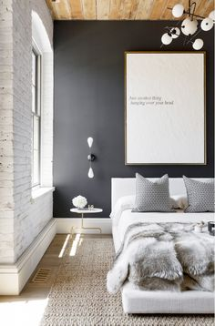 5 Ideas to Steal From a Chic, Textural Guest Bedroom via @domainehome | Texture is essential to any monochrome or single-tone space, as it keeps simple palettes from looking flat. In a guest bedroom, it's also important to integrate cozy materials, such as a faux fur throw or terry cloth bathrobe, to create a relaxing retreat for your guests. One of the easiest ways to add impact in any room is with large-scale artwork.