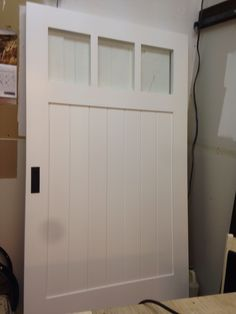 White barn door with frosted glass