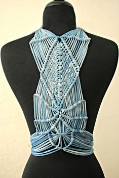 Interesting way to make macrame wearable, sorta trashy-chic look.