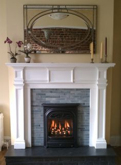"""We installed new """"quarter"""" tiles on the face of this old fireplace and installed a President gas insert to bring the fireplace back to life and add extra heat to this home. Another project from Victorian Fireplace Shop"""