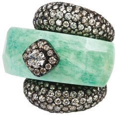 Mixing uncommon gemstones with diamonds is another way to make a bold statement without over doing it; like the jade shown in this chunky diamond ring.
