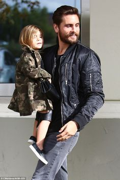Dapper: Scott, was casual in jeans and a leather jacket with his hair freshly slicked back while Penelope, three, wore a camouflage jacket over black leather capri pants and clutched a matching purse Scott Disick Hair, Scott Disick Style, Kardashian Style, Kourtney Kardashian, Kardashian Jenner, Scott And Kourtney, Camouflage Jeans, Suit And Tie, Kids Fashion