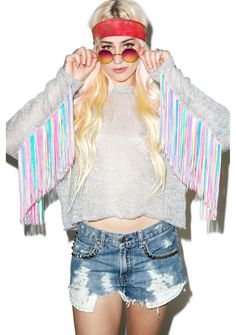 The Ragged Priest The Janice Jumper cuz yer just a boho babe on a rainbow trip. This fab grey sweater is made from an open knit material that's xtra soft 'n perfect to layer things underneath and features long sleeves with neon multicolored hanging fringe.