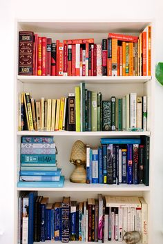 Books arranged on a shelf by color. Love it.