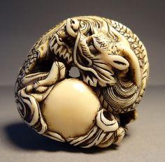 http://asia-flachsmann.com/assets/14-dragon-netsuke-1.jpg
