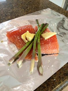 A perfect afternoon snack before dinner. Market fresh salmon with asparagus, salt, butter and fresh lemon. Cooked at 190degrees for 20minutes. Yum yum! -Tomi Kokko- Finnish Fitness Fanatic