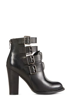 We love a good block heel; add some hardware, though, and she's divine! Isadore by JustFab is a block heel bootie with cutout detail at the top featuring thick buckled straps with chunky hematite hardware.
