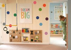 Designing Playspaces: Our Playroom from Fun at Home with Kids - Lego table, sensory boards, small trampoline, Expedit storage