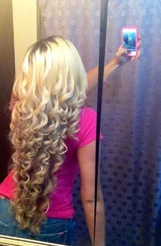 her hair is so long! i wish my hair was this long so i could have beautiful curls like her!
