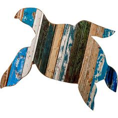 This Sea Turtle wooden wall plaque is hand made in the USA.This sea creature makes the perfect coastal decorative accent.� This folk art turtle is wonderfully  rustic, with all of the natural wood grain and imperfections adding to the patina. Up -cycled from re purposed barn wood in assorted old barn colors. This is a totally unique item no two the same. This wall art is environmentally friendly. The wire hanger on the back is also recycled and makes hanging simple.Sea Turtle are fascinat…