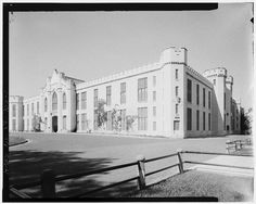 WEST FACADE AND SOUTH FACADE - Virginia Military Institute, Barracks, Virginia Military Institute Parade Grounds, Lexington, VA  Original design by A.J. Davis, 1848 and sub., burned during Civil War (1864), and rebuilt under direction of Davis (1870-73); of the subsequent additions to the original, one was (1892) by I.E.A. Rose and another (1918-19) by B.G. Goodhue, both relying heavily on earlier Davis drawings.