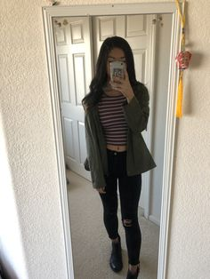 Olive green jacket, striped cropped shirt, ripped black jean outfit