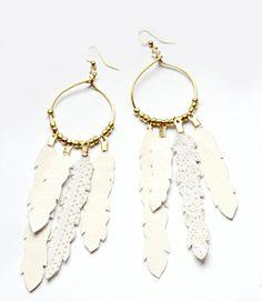#earrings #boho #feathers