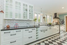 Contemporary Kitchen with Large Ceramic Tile, One-wall, Flush, Glass panel, Farmhouse sink, Limestone counters, Crown molding
