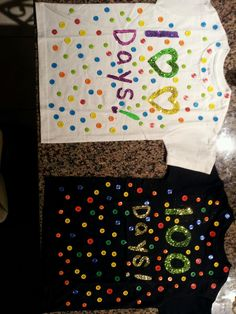 100 Days of School T-Shirts! 100 Buttons, Fabric Paint and Glitter was a must.