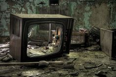 I think this is an interesting image that is suppose to represent how TV sets are being destroyed in the sense that most people now watch TV via their computers.