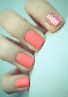 Trend spotting: coral and gold matte nails are a fun, modern way to show off this summer.