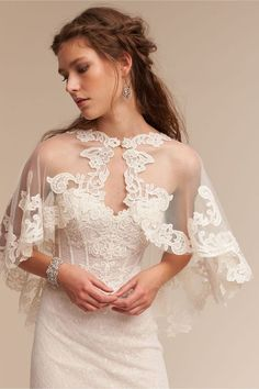 Adorlee Cape in Bride Bridal Cover Ups Explore the trend of Bridal capes and capletes! We've spotted 20 fab bridal capes and capeletes that are currently making our bridal hearts sing for joy. Covering up never looked so chic with wedding boleros, wraps, Wedding Cape, Bridal Cape, Wedding Bride, Wedding Gowns, Wedding Blog, Wedding Ideas, Lace Wedding, Wedding Bolero, Bhldn Wedding