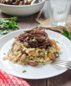 Beef Short Ribs with Mushroom Risotto are beef short ribs cooked in a crock pot until super tender. They're served over creamy mushroom risotto for the ultimate comfort food! @FlavortheMoment