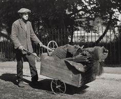 Chimney Sweep - Sussex, England 1932. Love the hand cart and the fact that he has a spare wheel.