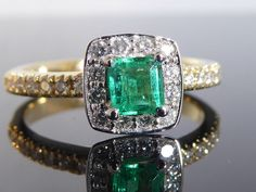 Catawiki online auction house: Diamond ring with natural deep bluish green Colombian emerald of 0.40 ct and 26 diamonds totalling 0.30 ct, no minimum price