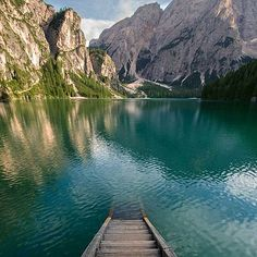 Perfection. Lake Braies Italy. Photo by Filippo Marietti via @naturalyouniverse