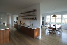 Open Floor Plan - modern - kitchen - new york - Jeff Chmielewski Love the brown wood with the white marble counters